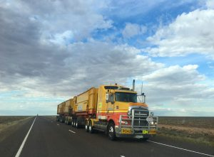 A big yellow moving truck on the road