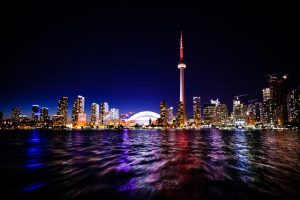 A view of Toronto landscape at night. By moving to Scarborough, you will be close to all that is hip and trendy about Toronto.