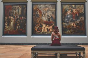 Woman sitting at the art gallery