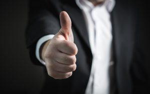 Businessman holding thumb up