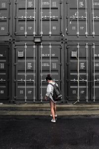 A woman in front of storage units