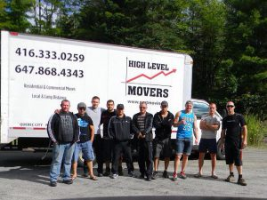 High Level Movers crew standing in front one of our trucks.