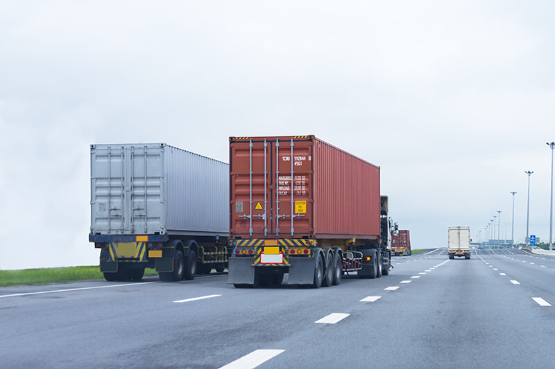 Image of trucks carrying container freight