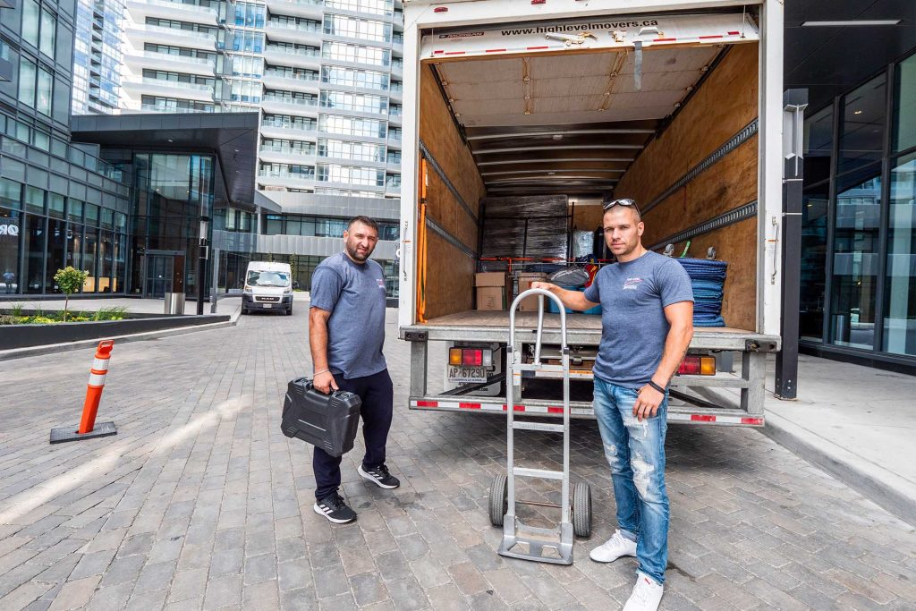 Photo of High Level Movers team and van